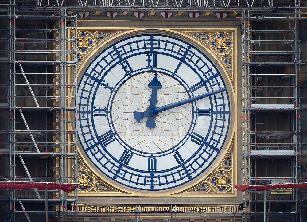© Licensed to London News Pictures. 20/03/2019. London, UK. The Elizabeth Tower clock face is revealed in its new Prussian Blue colour replacing the familiar black paint. Big Ben's north face is the first of the four famous clock faces to be seen in the original colour scheme from when it was built in 1859 by Sir Charles Barry. These works form part of a Parliamentary £61m restoration project which will also see the St George's shields at top of the clock face painted red and white for the first time since the 1930's.  Photo credit: Peter Macdiarmid/LNP