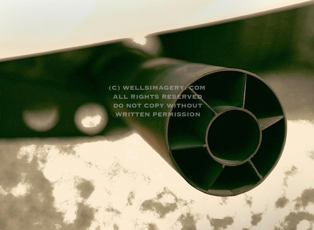 Image of a hot rod sports car exhaust tip megaphone muffler detail, photo illustration