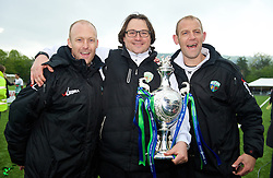 NEWTOWN, WALES - Saturday, May 2, 2015: The New Saints' manager Craig Harrison [C] and Steve Evans [R] with the FAW Welsh Cup trophy after the 2-0 victory over Newtown at Latham Park. (Pic by Ian Cook/Propaganda)