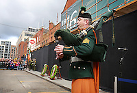 A Lone piper plays the  National Anthem after the wreath laying ceremony in Dublin's Moore Street. Picture Credit: Frank Mc Grath<br /> 28/3/16