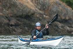 Mathew Paddles off San Juan County Park into the Haro Strait, San Juan Island, Washington, US