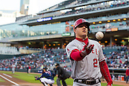 Mike Trout #27 of the Los Angeles Angels tosses a ball to a fan during a game against the Minnesota Twins on April 16, 2013 at Target Field in Minneapolis, Minnesota.  The Twins defeated the Angels 8 to 6.  Photo: Ben Krause