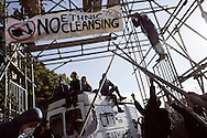 UNITED KINGDOM, Basildon :Activists stand on barricades above the main gate at Dale Farm travellers camp on September 19, 2011 in Basildon, England.  © Christian Minelli.