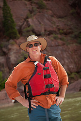 North America, United States, Colorado, Dinosaur National Monument, Green River (Gates of Lodore section), man in canyon wearing life preserver MR