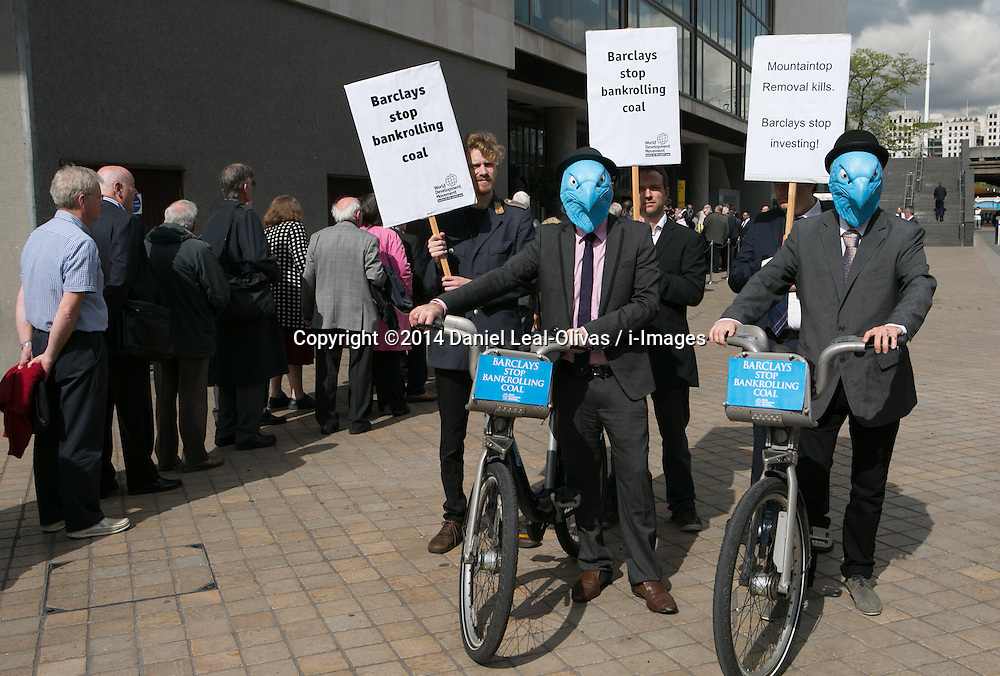Protesters call for Barclays to stop bankrolling coal and destroying the environment wearing blue masks Barclays 'eagles' on Barclays bikes at Southbank Centre, London, United Kingdom. Thursday, 24th April 2014. Picture by Daniel Leal-Olivas / i-Images