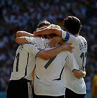 Photo: Glyn Thomas.<br />Germany v Sweden. Second Round, FIFA World Cup 2006. 24/06/2006.<br /> German players celebrate their second goal.