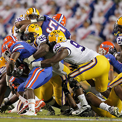 Oct 10, 2009; Baton Rouge, LA, USA; LSU Tigers defensive tackle Drake Nevis (92) and defensive end Lazarius Levingston (95) combine to tackle Florida Gators running back Jeffery Demps (2) during the first half at Tiger Stadium. Florida defeated LSU 13-3. Mandatory Credit: Derick E. Hingle-US PRESSWIRE