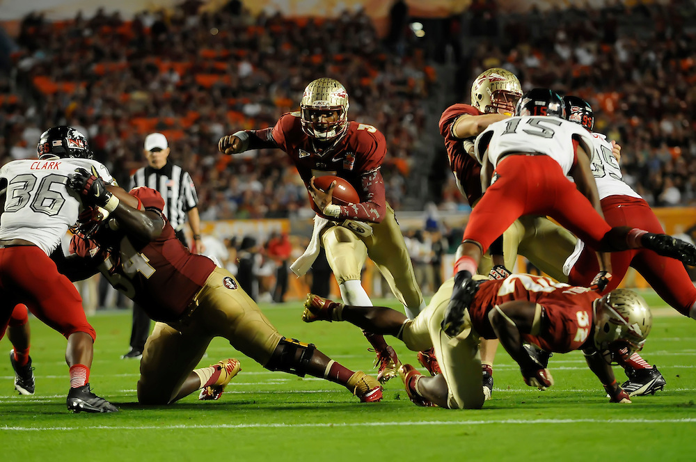 January 1, 2013: E.J. Manuel #3 of Florida State rushes for a touchdown during the NCAA football game between the Northern Illinois Huskies and the Florida State Seminoles at the 2013 Orange Bowl in Miami Gardens, Florida. The Seminoles defeated the Huskies 31-10.