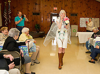 "The Friendship Club's Fashion Show with humor has Ella Brown taking the runway in her ""bridle"" attire accented with flowers and a ""reining"" train along with her 10 carot wedding ring, Yum!  Where's her horse and coach?  (Karen Bobotas/for the Laconia Daily Sun)"