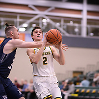 3rd year guard Samuel Hillis (2) of the Regina Cougars during the Men's Basketball home game on January 5 at Centre for Kinesiology, Health and Sport. Credit: Arthur Ward/Arthur Images