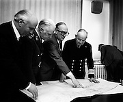 Paddy Donegan, TD, Minister for Defence (centre, wearing glasses) indicating on the map where five tonnes of arms and ammunition from LIbya, bound for the IRA, had been found on the ship Claudia, when it was intercepted near Helvick Head, Co Waterford. Also in the picture are members of the Naval Service and Army. <br />