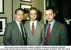 Left to right, brothers MICHAEL HYMAN, ANDREW HYMAN and DOMINIC HYMAN, sons of Ken Hyman the film producer, at an exhibition in London on March 18th 1997.LXD 8