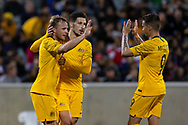 CANBERRA, AUSTRALIA - OCTOBER 10: Australian forward Jamie Maclaren (9) celebrates his goal with Australian defender Rhyan Grant (4) and Australian forward Matt Leckie (7) during the FIFA World Cup Qualifier soccer match between Australia and Nepal on October 10, 2019 at GIO Stadium in Canberra, Australia. (Photo by Speed Media/Icon Sportswire)