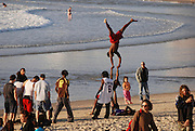 Israel, Tel aviv, Drum beach a group of young men of 20 doing gymnastic exercises on the beach