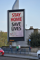 © Licensed to London News Pictures. 12/04/2020 London, UK. A sign on Shepherd's Bush Green, west London advising people to stay at home. Easter Day saw the death rate from COVID-19 in the UK pass 10,000 with some projections expected to exceed Italy and Spain, so far the worse hit countries in Europe. Photo credit: Guilhem Baker/LNP