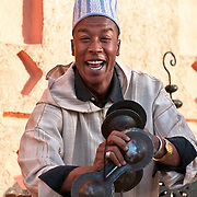 Moroccan man entertaining