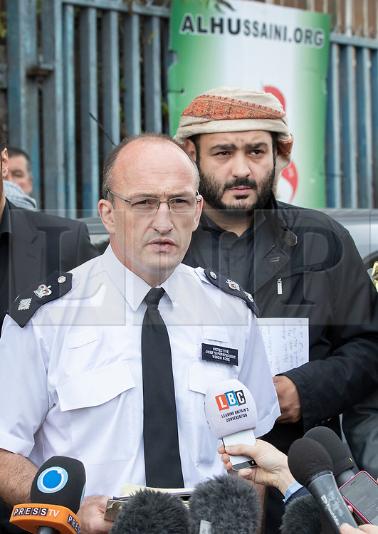 © Licensed to London News Pictures. 19/09/2018. London, UK. Detective Chief Superintendent Simon Rose (L) and Mustafa Al-Balaghi, a representive of The Hussaini Association Islamic Centre, talk to reporters in Cricklewood, north London where a car hit two pedestrians last night. The incident , which took place in the early hours of this morning outside the centre, is being treated as a possible hate crime. Police are looking for a male driver who failed to stop at the scene, as well as two men and one woman in the car, all in their 20s. Photo credit: Peter Macdiarmid/LNP