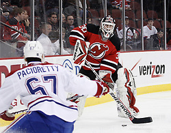 Dec 16, 2009; Newark, NJ, USA; New Jersey Devils goalie Martin Brodeur (30) moves the puck past Montreal Canadiens left wing Max Pacioretty (67) during the first period at the Prudential Center.