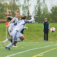 1st year forward Meghan McFee (27) of the Regina Cougars goes up for a header during the Women's Soccer home game on September 11 at U of R Field. Credit: Arthur Ward/Arthur Images