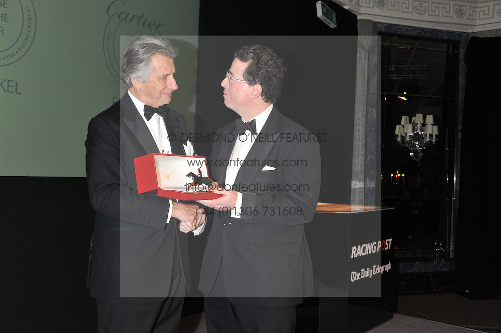 Left to right, ARNAUD BAMBERGER and LORD GRIMTHORPE at the 22nd Cartier Racing Awards held at The Dorchester, Park Lane, London on 13th November 2012.