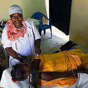 Médecins Sans Frontières (MSF) midwife, Viola Nizigiyimana, during a prenatal consultation with lalla Vatme Mint Naji (27), a refugee from Mali, in Fassala in southeastern Mauritania on 4 March 2013.