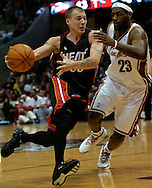 PHOTO BY DAVID RICHARD.Miami Heat's Jason Williams, left, attempts to get by LeBron James of Cleveland  April 1, 2006.