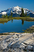 Alpine tarns of Yellow Aster Butte, American Border peak in the distance (2437 meters 7995 feet), Mount Baker Wilderness Washington USA beauty in nature