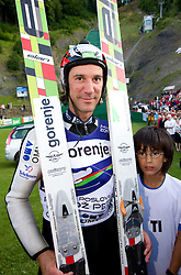 Primoz Peterka of Slovenia with his son Maj after Ski Jumping Summer Continental Cup in Kranj and last jump of Primoz Peterka's career, one of the best ski jumpers in history, on July 2, 2011, in Kranj, Slovenia. (Photo by Vid Ponikvar / Sportida)