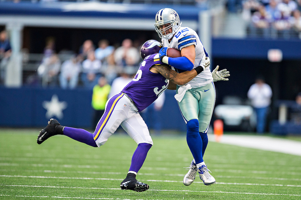 ARLINGTON, TX - NOVEMBER 3:  Jason Witten #82 of the Dallas Cowboys is tackled by Robert Blanton #36 of the Minnesota Vikings at AT&T Stadium on November 3, 2013 in Arlington, Texas.  The Cowboys defeated the Vikings 27-23.  (Photo by Wesley Hitt/Getty Images) *** Local Caption *** Jason Witten; Robert Blanton