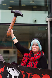© Licensed to London News Pictures. 09/10/2016. LONDON, UK.  Jane Nicholl from Class War, Women's Death Brigade at a protest outside Foxtons estate agent in Islington on 8th October 2016. The women only protest was a reaction to the alleged assault of Class War member, Jane Nicholl by a Foxtons employee during a protest outside Boris Johnson's house in July following which, three Foxton's employees were sacked after fighting with protesters and police. It has been reported that the Crown Prosecution Service (CPS) have recently dropped the assault against a Foxton's employee to Nicholl's due to a lack of evidence.  Photo credit: Vickie Flores/LNP