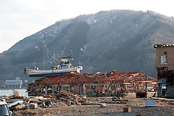 © under license to London News Pictures. 19/03/2011. A fishing boat  resting on the roof of a destroyed sushi restaurant in  Onagawa, Japan today (19/03/2011). Photo credit should read London News Pictures.