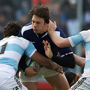 Remi Lamerat, France, is tackled by Manuel Montero (left) and Alan Kessen, Argentina,  during the Argentina V France group stage match at Estadio El Coloso del Parque, Rosario, Argentina, during the IRB Junior World Championships. 9th June 2010. Photo Tim Clayton....