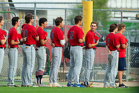 KELOWNA, BC - JULY 16:  The Wenatchee Applesox line up for the national anthem against the Kelowna Falcons at Elks Stadium on July 16, 2019 in Kelowna, Canada. (Photo by Marissa Baecker/Shoot the Breeze)
