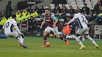 Football - 2016 / 2017 Premier League - West Ham United vs. West Bromwich Albion<br /> <br /> Robert Snodgrass of West Ham runs between Allan Nyom and Matt Phillips of West Bromwich Albion at the London Stadium.<br /> <br /> COLORSPORT/DANIEL BEARHAM