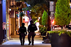 Tactical police officers walk along Danforth Avenue at the scene of a mass casualty incident in Toronto, ON, Canada on Sunday, July 22, 2018. A young woman has been killed and 13 others injured in a shooting incident in Toronto, Canadian police say. The Sunday night shooting happened in the Danforth and Logan avenues area. The gunman died in an exchange of fire. Among those injured is a young girl, described as in a critical condition. Police are appealing for witnesses. Photo by Frank Gunn/ABACAPRESS.COM