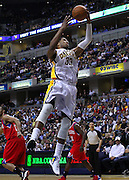 March 14, 2012; Indianapolis, IN, USA; Indiana Pacers small forward Danny Granger (33) snags a rebound against the Philadelphia 76ers at Bankers Life Fieldhouse. Indiana defeated Philadelphia 111-94. Mandatory credit: Michael Hickey-US PRESSWIRE