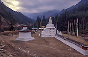 A buddhist stupa draws pilgrims in the Bumthang Valley.