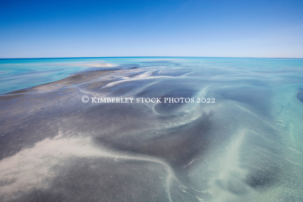 Seagrass and reefs are exposed as massive tides sweep around Roebuck Bay on the Kimberley coast.