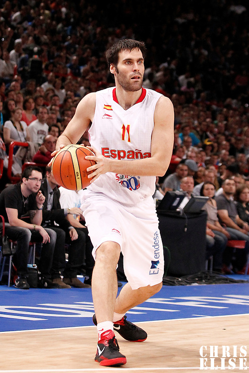 15 July 2012: Fernando San Emeterio of Team Spain looks to pass the ball during a pre-Olympic exhibition game won 75-70 by Spain over France, at the Palais Omnisports de Paris Bercy, in Paris, France.