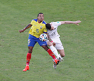 Michael Arroyo of Ecuador (L) is challenged by Laurent Koscielny of France during the 2014 FIFA World Cup Group E match at Maracana Stadium, Rio de Janeiro<br /> Picture by Andrew Tobin/Focus Images Ltd +44 7710 761829<br /> 25/06/2014