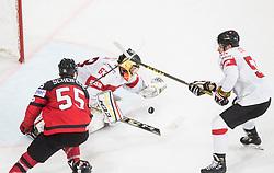 Leonardo Genoni of Switzerland vs Mark Scheifele of Canada during the 2017 IIHF Men's World Championship group B Ice hockey match between National Teams of Canada and Switzerland, on May 13, 2017 in AccorHotels Arena in Paris, France. Photo by Vid Ponikvar / Sportida