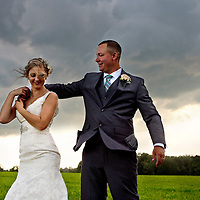Ashley & Jeremiah pictured just before a huge thunderstorm at their wedding at the Barn at the Backwoods in Thornville, in August.
