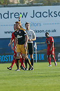 Cambridge United defender Mark Roberts  receives the yellow card during the Sky Bet League 2 match between York City and Cambridge United at Bootham Crescent, York, England on 3 October 2015. Photo by Simon Davies.