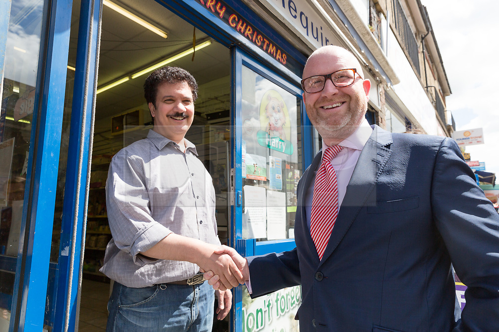 © Licensed to London News Pictures. 20/05/2017. LONDON, UK.  PAUL NUTTALL, UKIP leader meets a supportive local business owner in the High Street as he campaigns in Elm Park with UKIP candidate for Dagenham and Rainham, Peter Harris. All political parties continue to campaign across the UK ahead of the general election taking place on 8th June. Photo credit: Vickie Flores/LNP