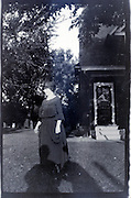 adult woman standing by house 1920s USA