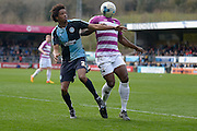 Wycombe Wanderers defender Sido Jombati (2) battles John Akinde of Barnet FC  during the Sky Bet League 2 match between Wycombe Wanderers and Barnet at Adams Park, High Wycombe, England on 16 April 2016. Photo by Dennis Goodwin.