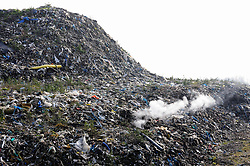 FILE PICTURE © Licensed to London News Pictures. 11/03/2016<br /> <br /> Abandoned rubbish mountain (Waste4fuel site) on fire again this afternoon.<br /> <br /> The Waste4fuel site in St Pauls Cray,Orpington,Kent continues to be an eyesore and a blight to the local community. Legal issues are holding up the removal of the rubbish from the site.<br /> <br />  (Byline:Grant Falvey/LNP)