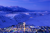 Aerial view of the town of Jackson and the Teton mountain range at dusk in Jackson Hole, Wyoming.
