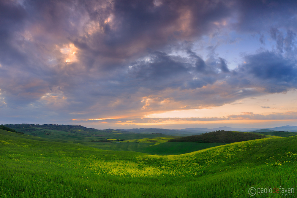 The sky started to clear off right at sunrise, after a night of mighty thunderstorms. Taken in the hills between Pienza iand San Quirico d'Orcia in Tuscany, Italy, on a morning at the beginning of May.