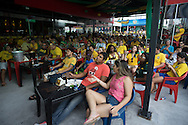 Brazilian fans crammed into an open air bar to watch the Brazil v Croatia match in Manaus near to the Arena da Amazonia, Manaus, Brazil<br /> Picture by Andrew Tobin/Focus Images Ltd +44 7710 761829<br /> 12/06/2014